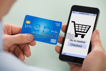 person shopping on mobile phone
