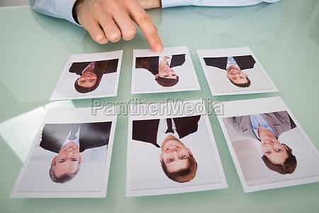 businessman hand choosing photograph of a