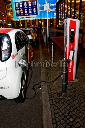 electric car is charged at a