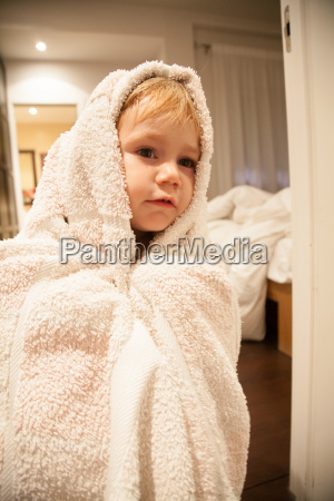 baby wrapped in towel
