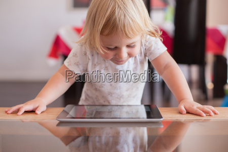 smiling baby watching tablet