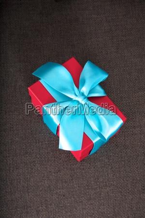 present box on brown textured background
