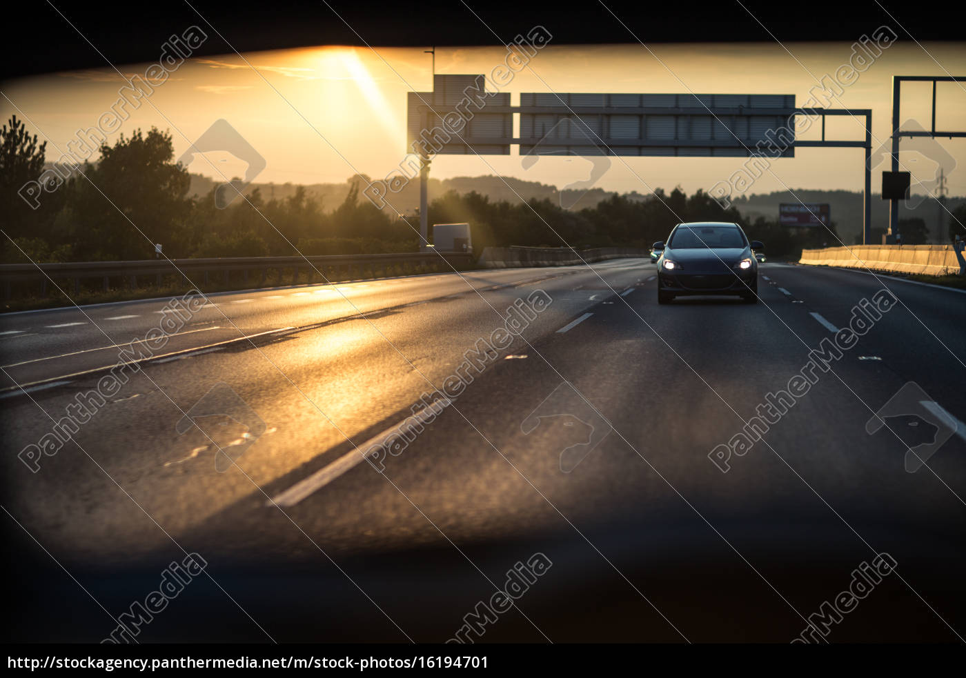 cars, on, a, highway, at, sunset - 16194701