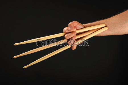 wolverine hand with three drumsticks over