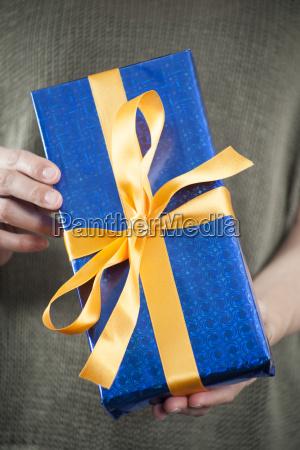 blue present in female hands