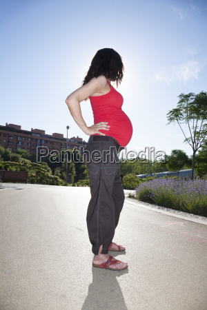 red pregnant woman side