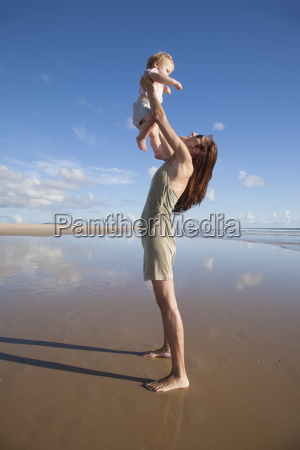 woman with baby flying in her