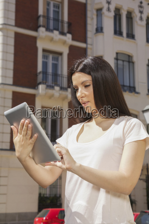 young woman with tablet portrait