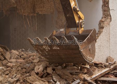 a large track hoe excavator tearing
