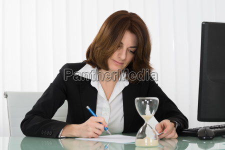 businesswoman filling form in office
