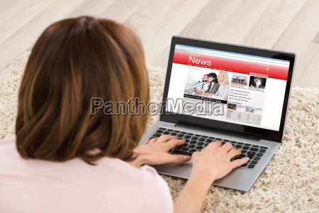 woman watching online news site on