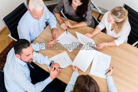 lawyers in chambers read contracts and
