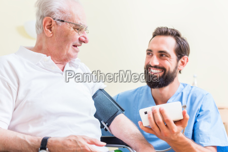 senior man and caregiver in retirement