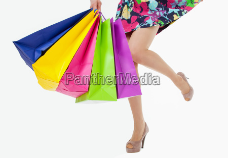 happy young woman with multicolored shopping