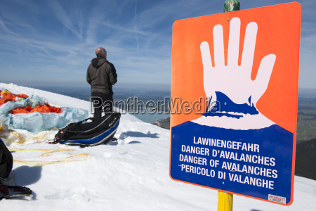 avalanche danger sign with man horizontal