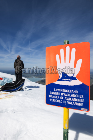 avalanche danger sign with man vertical