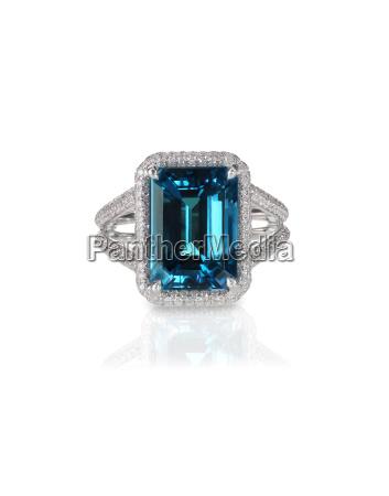 aquamarine center stone ring with diamond