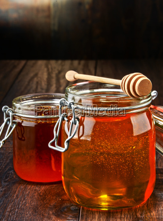 composition with jars of honey on