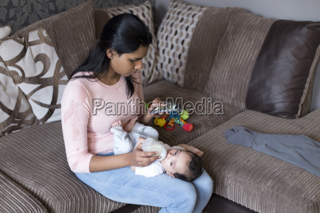 multitasking mother on phone