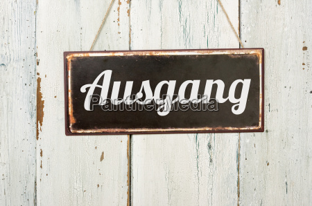 old metal sign in front of