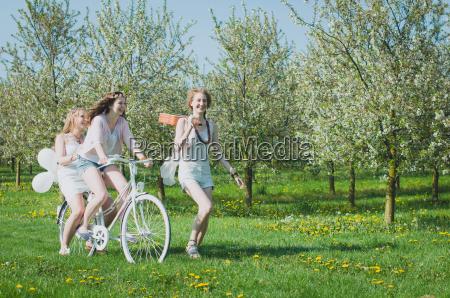 young women in cherry garden