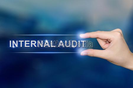 hand clicking internal audit button