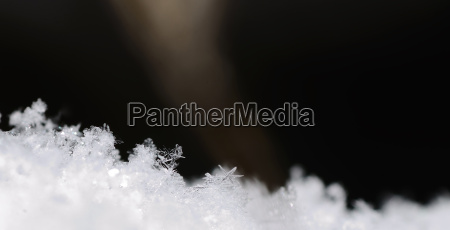 delicate snow crystals in winter panorama
