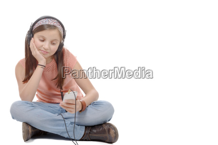 preteen girl listening to music with
