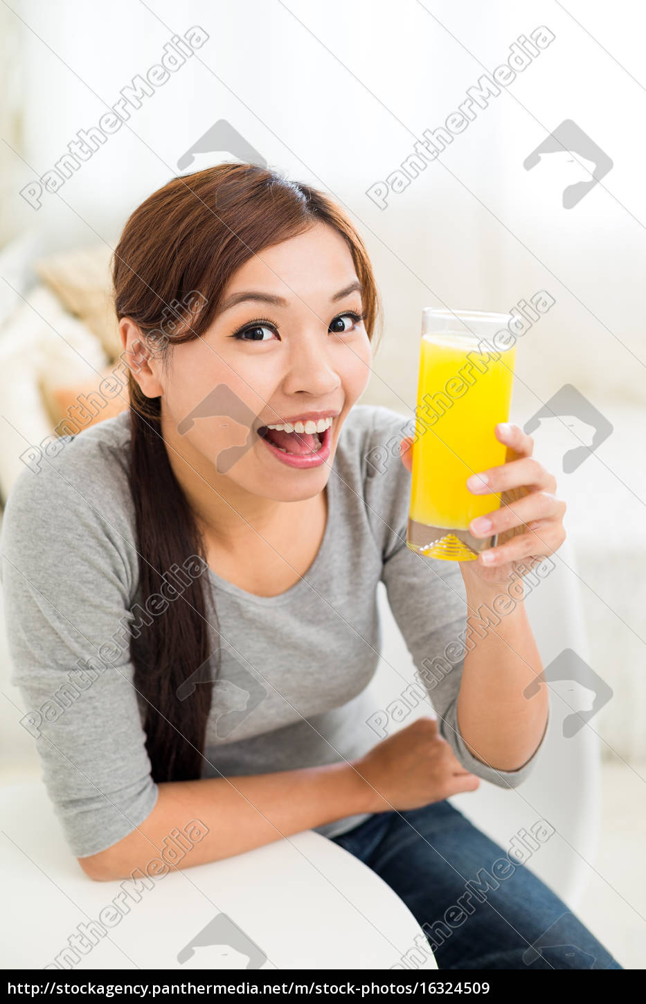young, woman, drink, with, orange, juice - 16324509