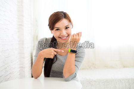 young, woman, with, wearable, sport, watch - 16324605