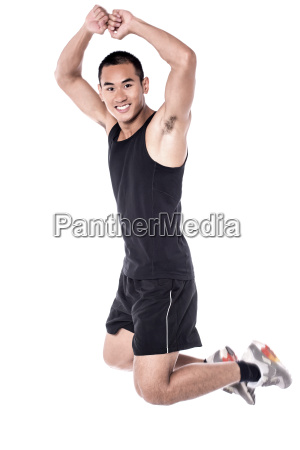 jumping, man, in, a, sport, outfit - 16327331