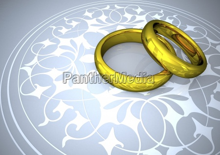wedding rings on white ornaments