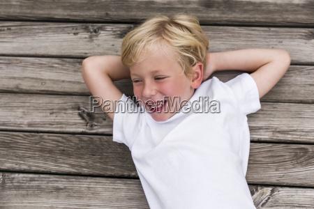 portrait of laughing little boy lying