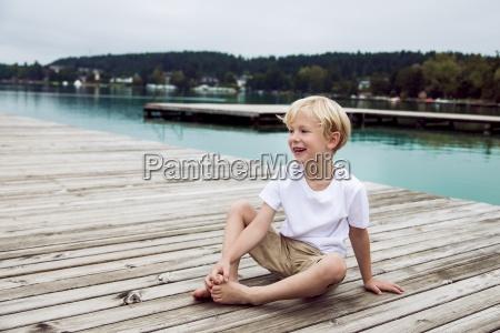portrait of smiliing little boy sitting