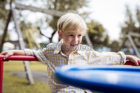 portrait of little boy watching something