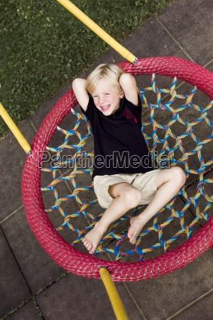 portrait of little boy relaxing on