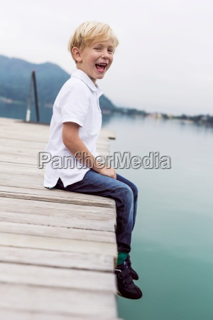 portrait of laughing little boy sitting