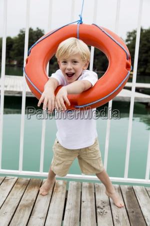 portrait of little boy looking through