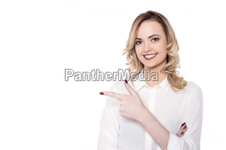 charming woman pointing by her side
