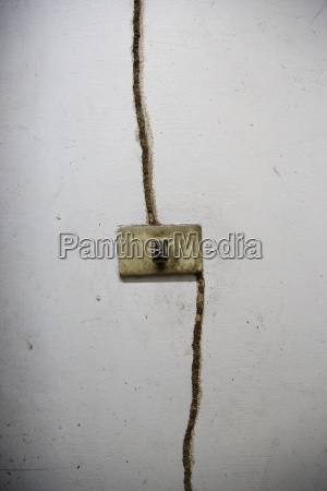 light switch and crack in wall
