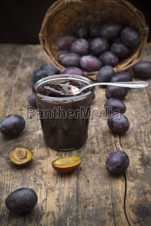 preserving jar of plum jam and