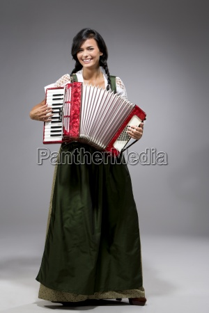 portrait of young woman with accordion