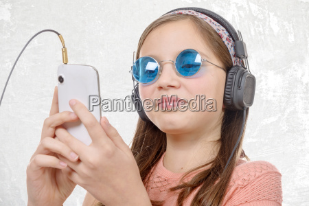 preteen, girl, listening, to, music, with - 16339423