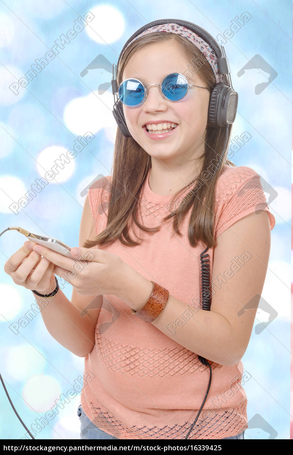 preteen, girl, listening, to, music, with - 16339425