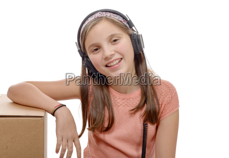 preteen, listening, to, music, with, headphones - 16339391