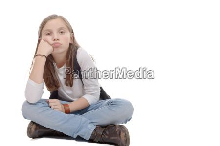 pretty, little, girl, sitting, cross-legged., isolated - 16339393