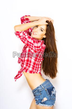 beautiful, woman, posing, in, tied, shirt - 16340201