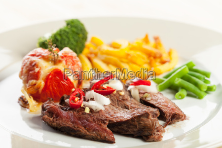 grilled steak with french fries and