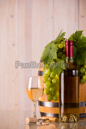 glass of wine with grapes and