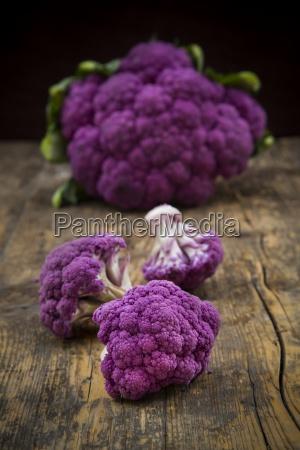 whole purple cauliflower and cauliflower florets
